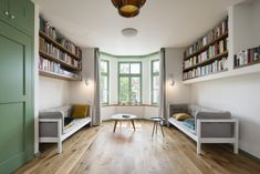 Image 7 of 36 from gallery of Baugruppe House / No Architects. Photograph by Studio Flusser Bookshelves, Bookcase, Living Spaces, Living Room, Reading Room, Elle Decor, Bunk Beds, Corner Desk, Studios