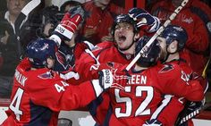 Washington Capitals' Alex Ovechkin (2nd L) celebrates his second period goal against the Boston Bruins with teammates Roman Hamrlik (L), Mike Green and Brooks Laich (R) during Game 3 of their NHL Eastern Conference Hockey playoff quarter-finals in Washington, April 16, 2012. REUTERS/Larry Downing