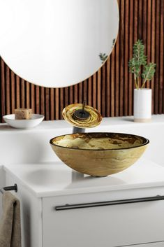 Vibrant swirls of embedded gold and auburn foils dance around the polished surface of this glass vessel sink. Gold Bathroom Faucet, Bathroom Spa, Glass Vessel Sinks, Bathroom Goals, Bath Design, Bath Decor, Kitchen And Bath, Plates, Mirror