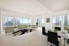 Breathtaking views complement an open layout living room in the penthouse at The Sheffield