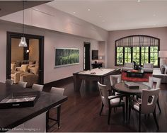 Modern Chic Media & Game Room. Separate Home Theatre room from amazing game room & bar area.