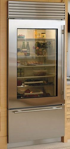 the fact that Sub Zero fridges are fabulous I love the window look of this fridge Plus it will remind us to keep the meat veggies cheese beer and wine neatly organized See Through Refrigerator, Glass Door Refrigerator, Stainless Steel Refrigerator, Subzero Refrigerator, Clean Refrigerator, Bottom Freezer Refrigerator, Refrigerator Organization, Sub Zero Fridge, Stove Heater