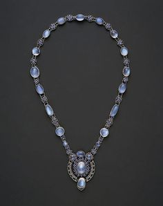 Designed by Louis Comfort Tiffany (American 1848–1933). Necklace with Pendant, ca. 1910. Moonstones, sapphires, platinum. The Metropolitan Museum of Art, New York. Gift of Susan Dwight Bliss, 1953 (53.153.7). #jewelry #tiffanys