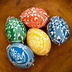 Use a white wax crayon to scrawl designs on your egg before dying it. For extra points, after it's dry, melt off the wax and repeat the process in a ...