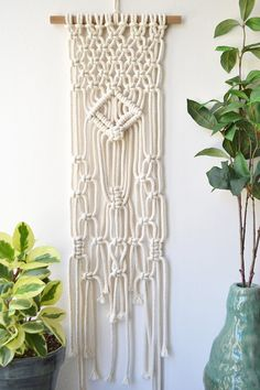 Macrame Wall Hanging handmade in Chicago. This macrame wall hanging is classic in design, the perfect size to complement any wall and adds the right amount of texture to any home decor need. The unique pattern and boho design adds special interest to this classic style. Materials: 100% High Quality