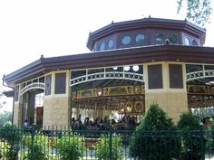 "The Cafesjians Carousel at Como Park in St. Paul, Minnesota.  Built in 1914 at a cost of $8500, it was commissioned for use at the Minnesota State Fair where it stood until 1988 when it was put up for auction.  At this time and organization called ""Our Fair Carousel"" formed to preserve the iconic landmark.  After a 10 year restoration project, it was first housed at Bandanna Square in St. Paul and eventually was moved to its own pavilion in St. Paul's Como Park."