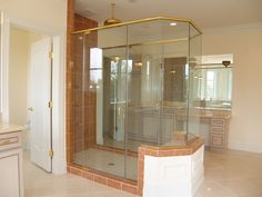 """Custom unit shown in Brass with clear glass and 3/8"""" thick at 80"""" tall. Visit Showroom Partners online where we offer a lot more than just shower enclosures."""