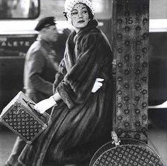 Simone D'Aillencourt, supermodel in the 1950-1960's photographed with Louis Vuitton trunks, photographed by Henry Clarke