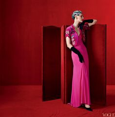 .Model Guinevere Van Seenus wears the designer's shocking-pink dress (fall 1937), silk-velvet bolero with metal embroidery by Lesage (fall 1938), and Starburst earrings, c.mid-1930s. Daniel Storto gloves. All Schiaparelli Haute Couture pieces courtesy of Collecton Mark Walsh Leslie Chin; vintageluxury.com. Fashion editor: Grace Coddington Photographed by Steven Meisel