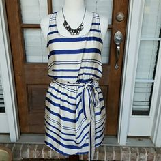 Aqua Blue and White Zipper Dress Beautiful dress. Very flowy. 100% polyester. Perfect condition. Zipper details on edges. Aqua Dresses