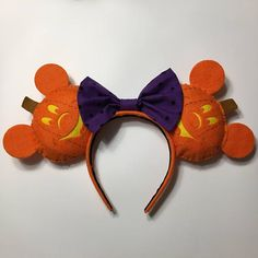 Handmade Mickey Jack-o-Lantern ears to show your Halloween spirit! These ears are made with a superb wool blend felt and a cotton bow The headband is 1 tapered, covered in a matching felt, and lined with velvet so its non-slip without being too tight. Wear them on your next trip to Mickeys Not So Scary Halloween Party!