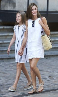 Spain's Queen Letizia, with daughter Princess Sofia, looked cool in a little white dress and jeweled sandals during her vacation in Mallorca on August 6.