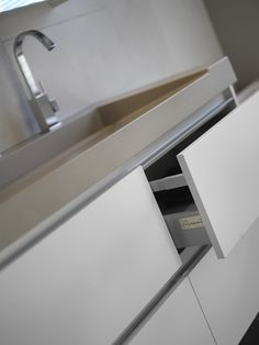 Assenti bathroom furniture tailor made. White mat base cabinet combined with solid surface wash basin in concrete light.