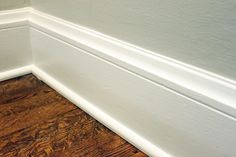 Our First Nest: Bathroom Redo Baseboard Heating, Baseboard Molding, Floor Molding, Moulding, Molding Ideas, How To Install Baseboards, Installing Wainscoting, Painting Baseboards, Painting Trim