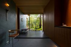 located in a quiet residential neighborhood, japanese practice uemachi laboratory has crafted a family home that forges an intimate relationship with the natural environment. Nara, House Entrance, Entrance Hall, Sea Container Homes, Natural Interior, Japanese Interior, Japan Design, Japanese House, Residential Architecture
