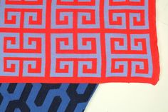 greek key eco throw by happy habitat in bright coral and lilac (shown with Tribal in Marine/Ocean)