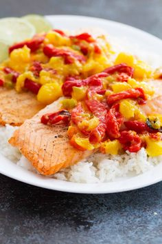 This Salmon with Mango and Roasted Red Pepper is a restaurant worthy dinner, minus the hefty price tag! Filled with lots of sweet and savory flavor, this is a 30 minute dinner you'll come back to over and over again. Easy Fish Recipes, Simply Recipes, Seafood Recipes, Healthy Recipes, Healthy Food, Dinner Recipes, Enchilada Casserole Beef, Beef Enchiladas, Roasted Red Pepper Sauce