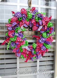 Ribbon and balloon wreath . . . add a monogram to the middle, too.