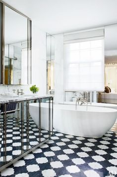 Mirror forms (wall and console). Designed by Philip Vergeylen near London's Hyde Park. Featured in Architectural Digest as seen in La Dolce Vita blog.