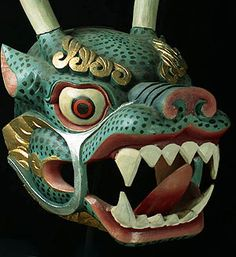 Deer Dragon Mask of Bhutan  Usually at least two deer (shar in Bhutanese) dancers are the main players in the sharcham New Year dances. The two deer headed figures, robed in fine brocade, enact a graceful dance that culminates in them swinging swords and chopping to bits a large clay figure that personifies the evils of the coming year.