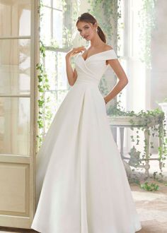 Mori Lee 5712 Providence Portrait Neckline Wedding Gown Styled in peau de soie, this Mori Lee Blu 5712 Providence off-the-shoulder bridal ball gown features a side gathered bodice with … Western Wedding Dresses, Bridal Wedding Dresses, Wedding Dress Styles, Lace Wedding, Mori Lee Wedding Dress, Trendy Wedding, Autumn Wedding, Satin Wedding Gowns, Elegant Wedding
