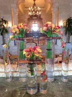 We're more than romantic wedding florals! This artistic and sculptural arrangement of mango mini calla lilies makes a statement in the The Ritz-Carlton Orlando, Grande Lakes lobby lounge.