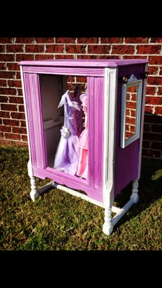 Dress up station repurposed from an antique radio.  Painted by Amber of Hart & Soul Designs, Huntsville, AL