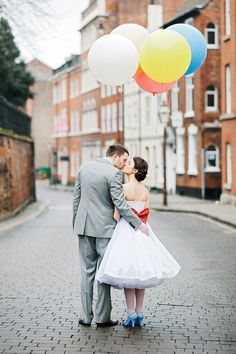 Bride and Groom in the street with balloons #love