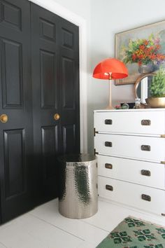 Campaign furniture love. Painting reminds me of painting that I'm considering hanging with a simpler frame. http://littlegreennotebook.blogspot.com/2015/06/14-ways-to-beautify-your-closet-doors.html