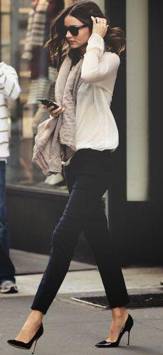 Skinny pants with cream top, scarf & black heels.