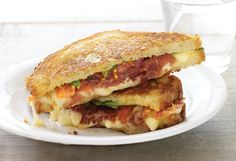 A grilled sandwich with Gruyère cheese and layers of prosciutto, arugula and tomato. #grilledcheese