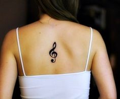 What does treble clef tattoo mean? We have treble clef tattoo ideas, designs, symbolism and we explain the meaning behind the tattoo. Music Tattoo Designs, Music Tattoos, Small Tattoo Designs, Back Tattoo Women, Back Tattoos, Tattoos For Women, Future Tattoos, Treble Clef Tattoo, Note Tattoo