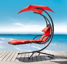"Renava Bahama - Modern Red Metal Dream Chair. Dimensions: W77.5"" x D40"" x H79"" Color: Pink Finish:   - Modern Hammock BedUmbrella attached for shadeCushioning provides one-of-a-kind comfort that is not too soft, and not as firm. Color:  Red"