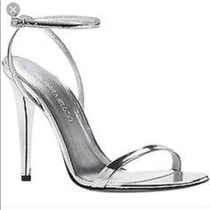 Tamara Mellon Silver heels Tamara Mellon, founder of Jimmy Cho. Wore once. Bought at Saks. Shoes Heels