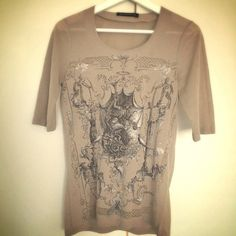 ⏬LOWEST! Balenciaga transparent art tee CLEARANCE PRICE! NO OFFER ACCEPTED, thanksThis is beautiful top from Balenciaga, 100% auth. I bought from balenciaga boutique at SCP directly. Elbow length sleeves, no rib on neck or hem so that makes this tops look more gorgeous than regular tee. Beige color. Art print on front with some part transparent. It's really good to wear under the jacket. In great used condition, worn a handful times always hand washed. In size FR36, fits like US 2. No…
