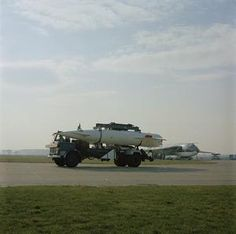 A Blue Steel stand-off missile being lowered from a transporter on to a trolley prior to be loaded on an awaiting Handley Page Victor aircraft [unseen], probably of No 100 Squadron at RAF Wittering, Northamptonshire. Handley Page Victor, V Force, Avro Vulcan, Post War Era, Air Force Aircraft, History Online, Royal Air Force, Royal Navy, Cold War