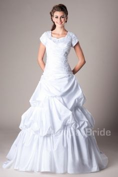 Perry | This taffeta ballgown features lace and ruching on the bust, completed with dramatic pick-ups to finish the skirt. Gown available in Ivory or White (shown).  Modest Wedding Dress | Modest Wedding Gown | LatterDayBride | LDS | SLC | UT | Salt Lake City | Utah | Worldwide Shipping |