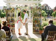 """How sweet is this wedding """"arch""""? If you love reading this theme is for you!"""