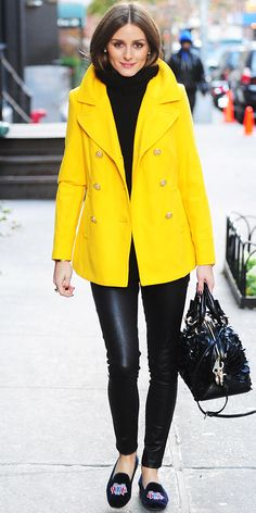 Olivia Palermo - yellow Old Navy coat that she + a chunky sweater, leather leggings, a convertible tote and velvet slippers.