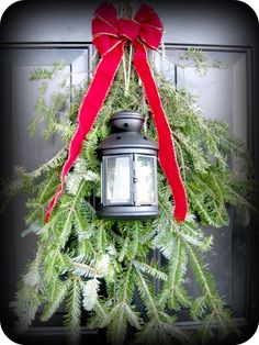 Front door greenery with lantern