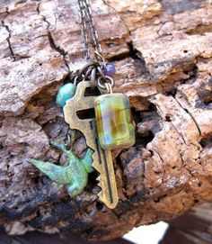 Key & Bird Cluster Necklace by TinyYellowKeyDesigns on Etsy, $24.00