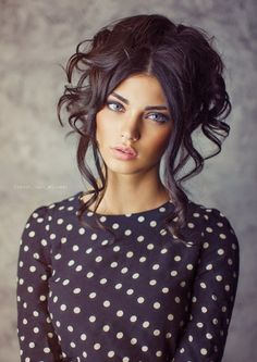 Cool Messy Updo with a Parted Fringe