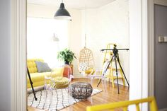 Love the yellow sofa with the black & white