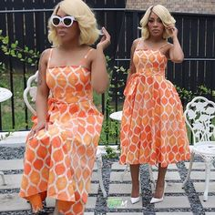 """R&B reality star #KMichelle gets her """"I'm a sophisticated-Caucasian-white-woman"""" on in pretty orange summer dress and new blonde bob."""