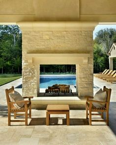 Pool with outdoor fireplace