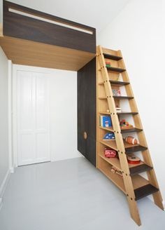 floating loft over door. good use of otherwise underused space