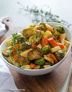 Maple Thyme Roasted Brussels Sprouts, Carrots, and Parsnips are an easy side dish that the whole family will love!