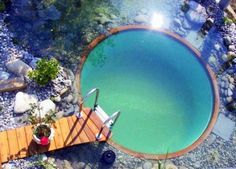 This gorgeous swimming pool isn't a typical chlorine-filled watering hole–it's actually a natural swimming pond that relies on plants to filter the water. Even if you already have a conventional swimming pool, you can enjoy the benefits of a chemical-free pond and relaxing natural environment using the structure you already have with a few design changes.