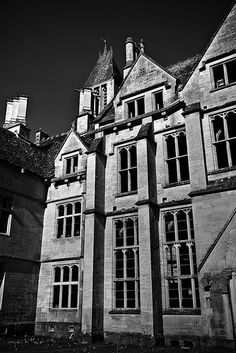 Woodchester Mansion by ©ross•P®ocess, via Flickr Woodchester Mansion is an unfinished, Gothic revival mansion house located in Woodchester Park near Nympsfield in Woodchester, Gloucestershire, England.   The Mansion was abandoned by its builders in the middle of construction, leaving behind a building that appears complete from the outside, but with floors, plaster and whole rooms missing inside. It has remained in this state since the mid-1870s.  The house is claimed to be haunted -