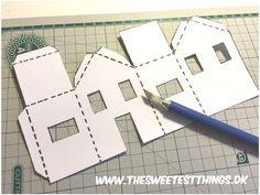 DIY: Winter Village – papirshuse De små papirhuse vil pynte i ethvert snelandskab. De er også rigtigt søde i vindueskarmen med et LED fyrfadslys i, som vil lyse husets små vinduer op. Jeg har…